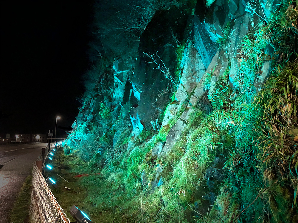 Green lighting on cliff face from Luxeos 09 RGBW luminaires
